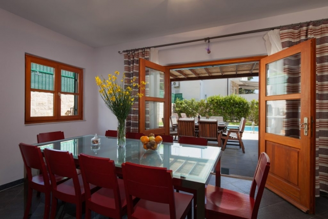 Dining room with open French door and the view at the swimming pool