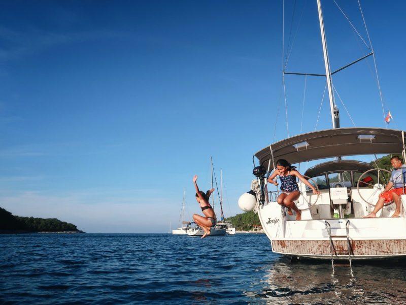 Kids enjoying summer activities at the sailing boat at the island of Hvar