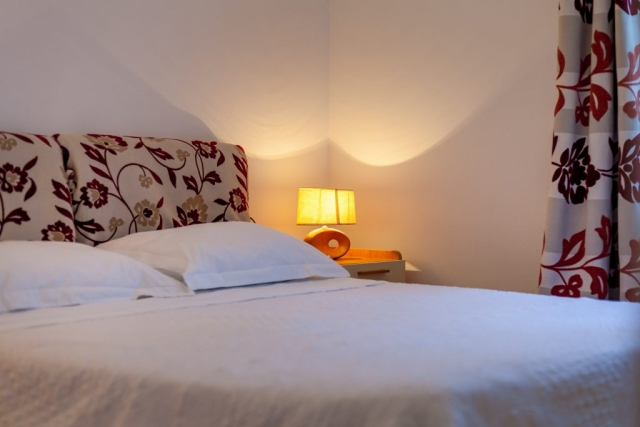 Comfortable bed in Villa s Dane double bedroom
