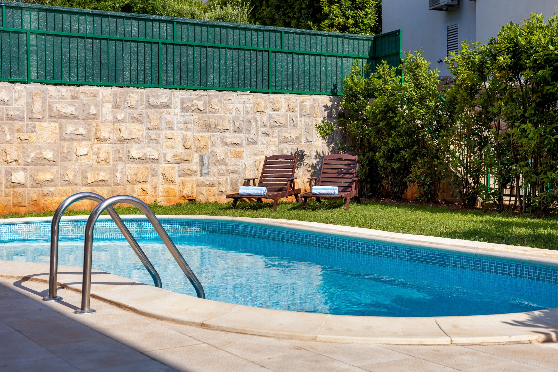 Private swimming pool with relaxing bed chairs