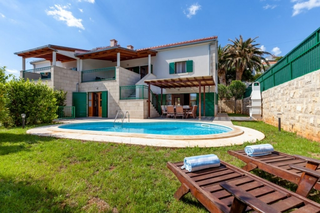 Sunlit Villa Dane with swimming pool and bed chairs
